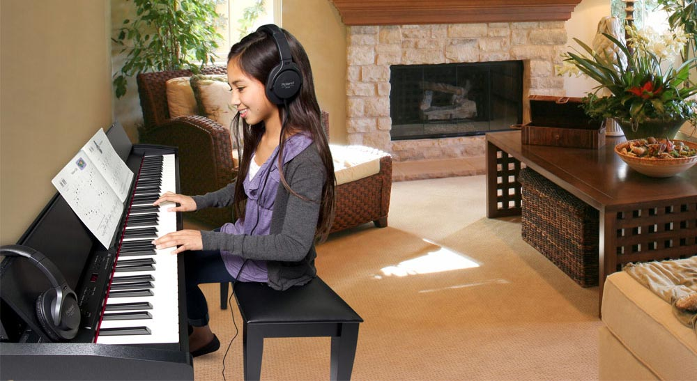 Student Playing Roland F-120 Digital Piano