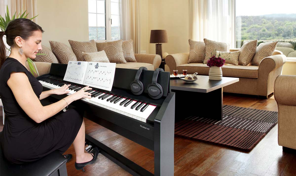 Woman Playing Roland F-120 Digital Piano