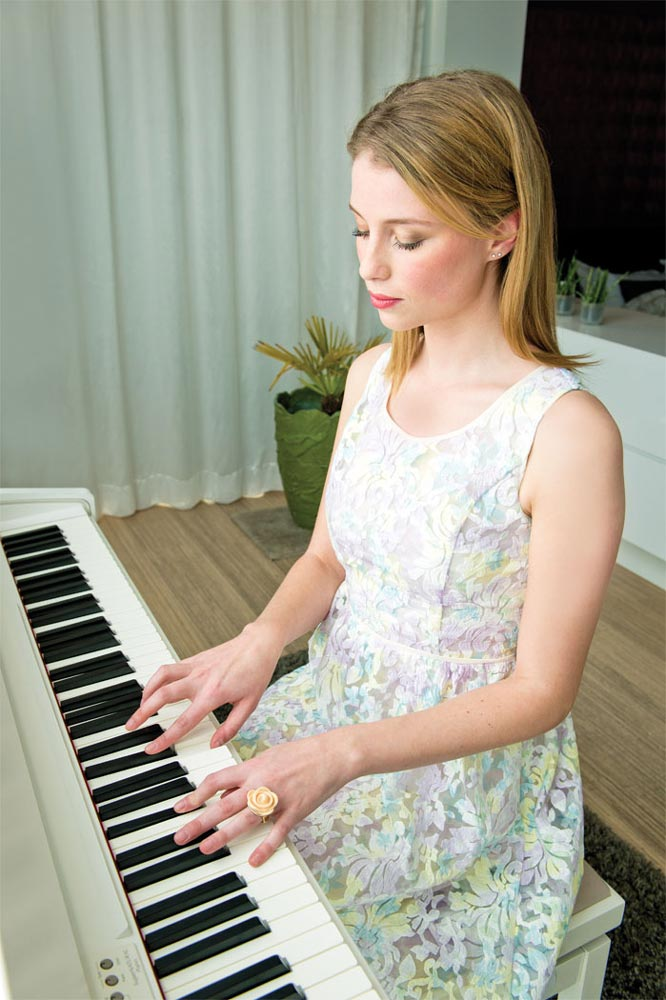 Student Playing Roland F-130R Digital Piano